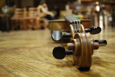 Violin Musical Instrument Lying on a Wooden Floor