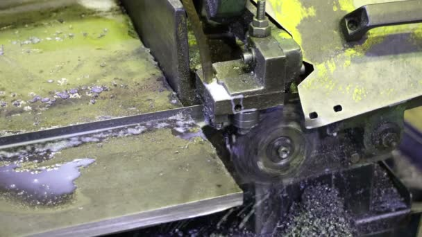 sawing a metal plate on the cutting line flying chips dripping drops