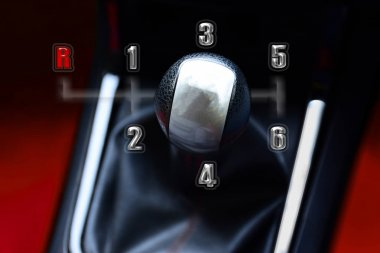 Gear stick for manual transmission for driving in car.