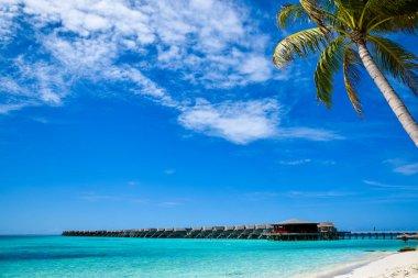 Water bungalows at beautiful tropical Maldives island luxury resort