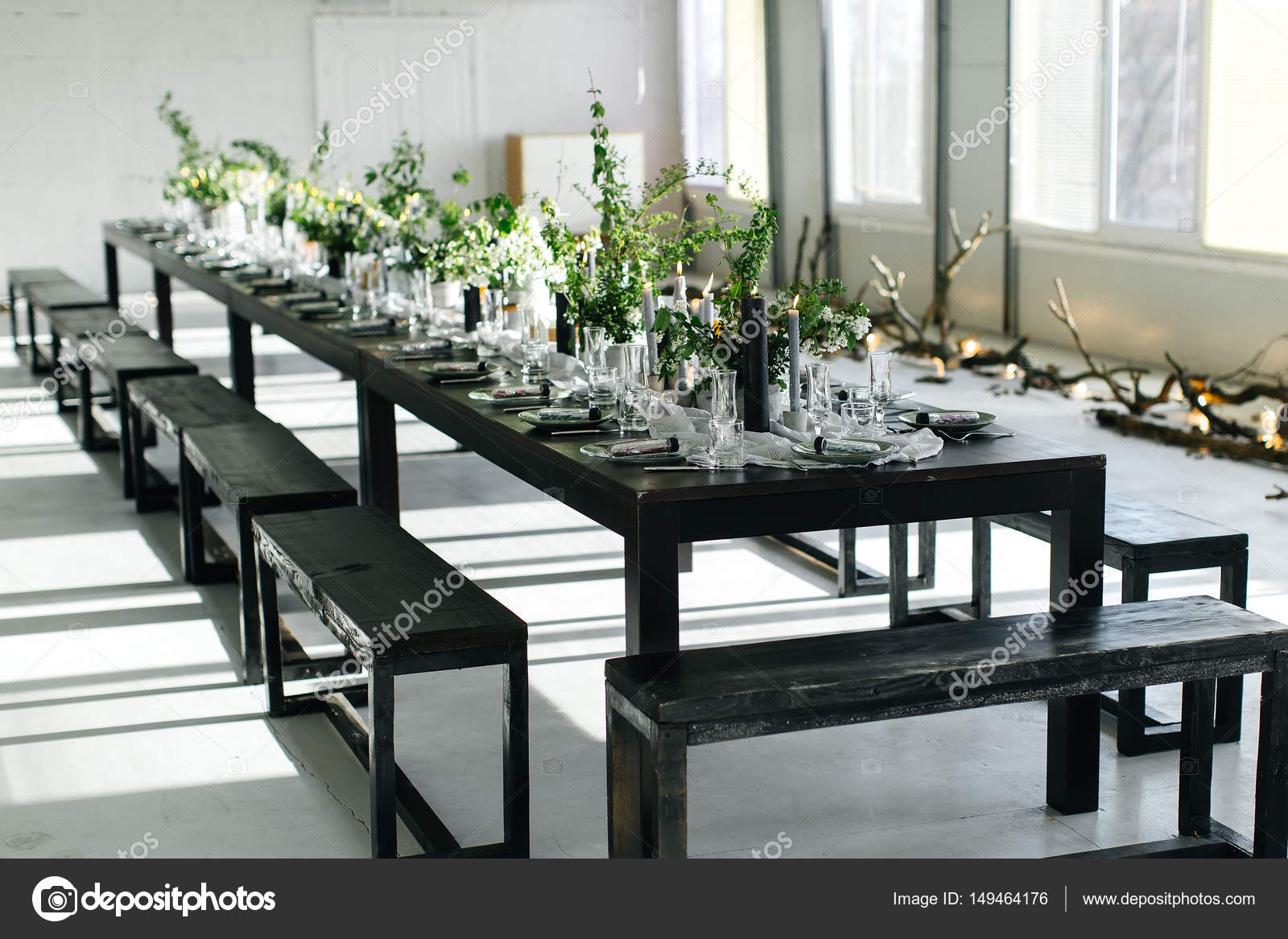 Stylish table loft design room in the loft style black table design room in the loft style black table chairs dishes candles jars with greens photo by savvopuloockgmail dzzzfo