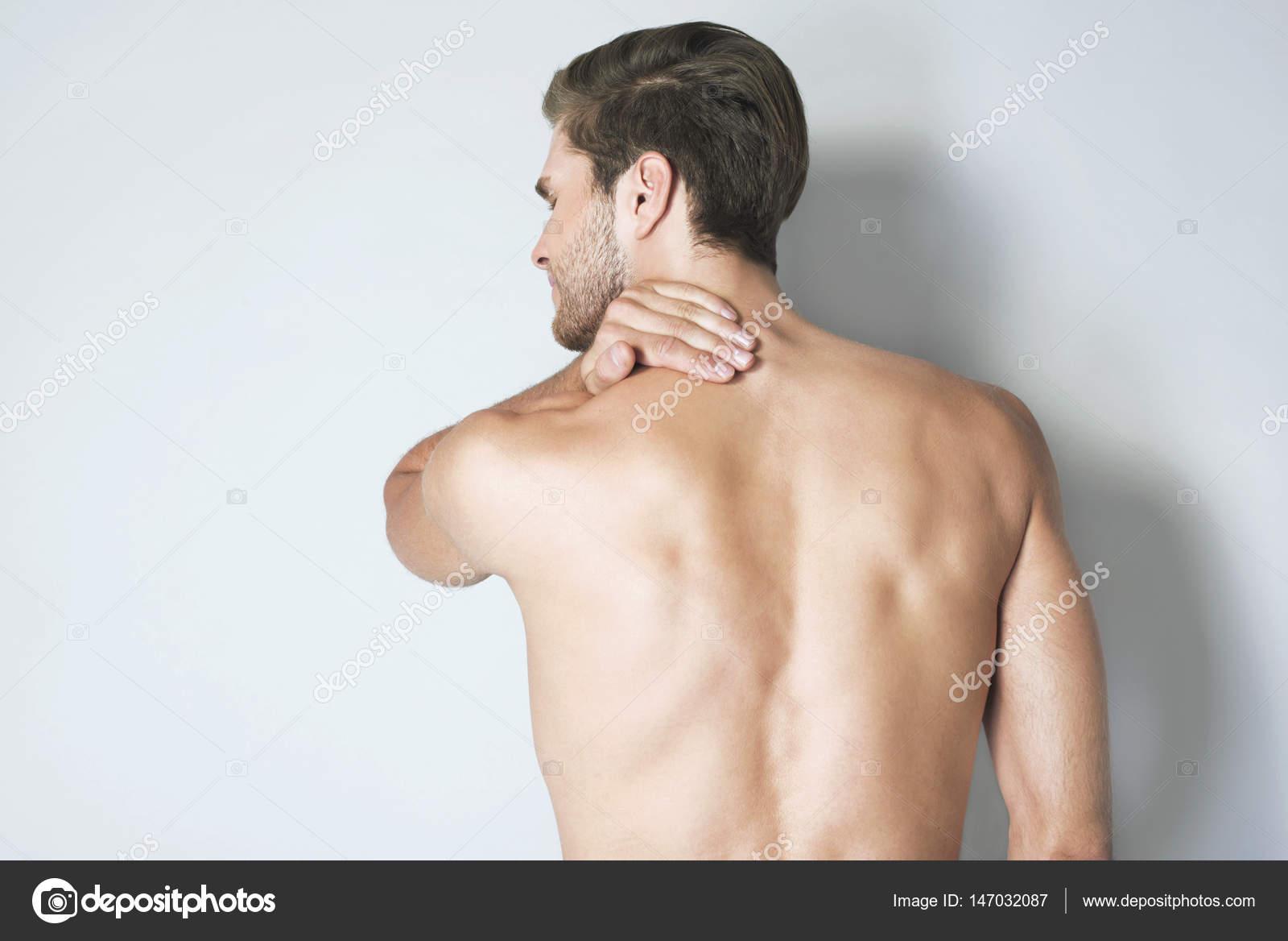 Muscular Naked Man On Black Stock Image