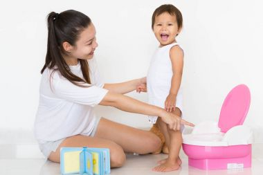 Mother successfully teaches child potty training