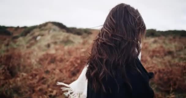 Beautiful charming young girl walking in the mountain edge flirting posing for the camera. smiling. 4k