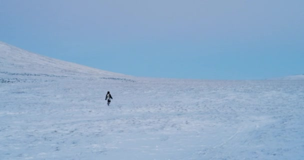 4k footage, aerial view man in warm clothes walking alone on wide on cold  winter afternoon  Red Epic