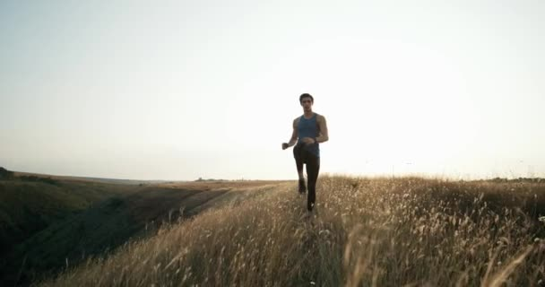 Young athletic man doing warm-up before exercise and jogging. Exercise in motion.