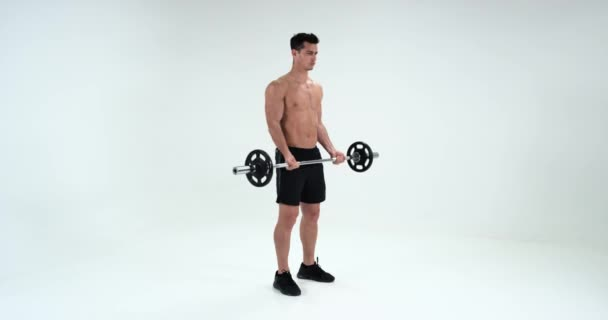 Man with dumbbell flexing muscles on white background, sport, bodybuilding, lifestyle. Exercising biceps . Red Epic.