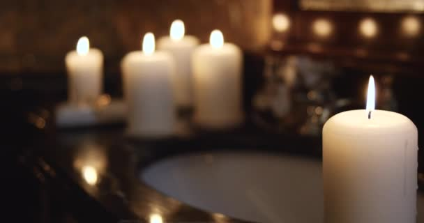 White flickering candles in bathroom with classic design