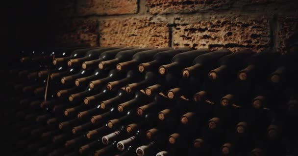 Old bottles of red wine in a cellar. red epic . 4k