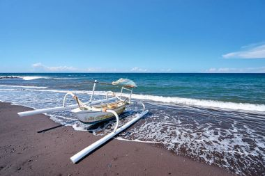 beach and indonesian fishing boat.