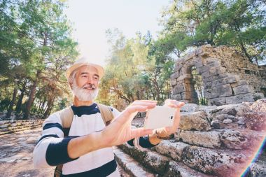 Senior man taking photo