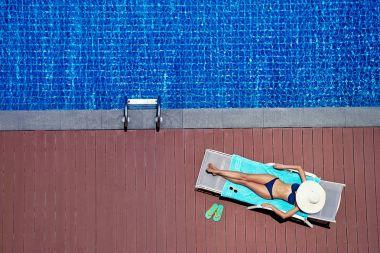 Woman in bikini on sun lounger