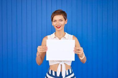 Woman showing empty blank