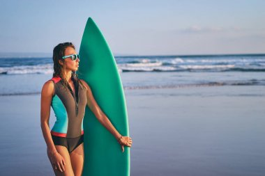 Woman holding surf board
