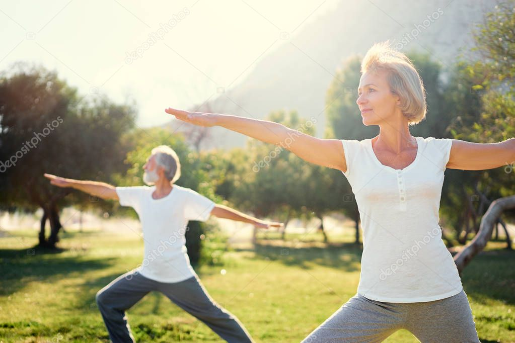 Senior family exercising outdoors