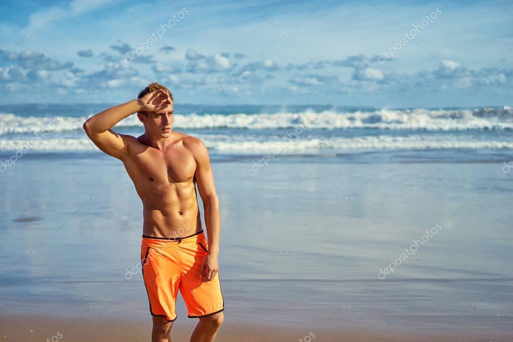 Man standing on sea beach