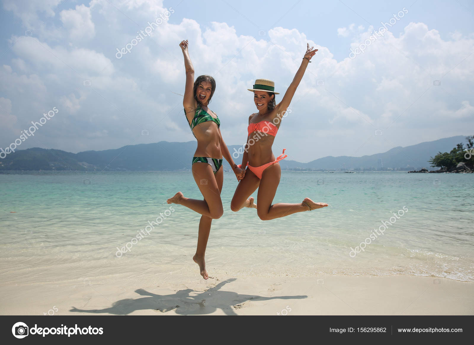118c398b03a62 Two cool trendy hipster girls jumping on the beach enjoying vacation on a  tropical island, perfect tanned body, sexy stylish casual wear, bikinis —  Photo by ...