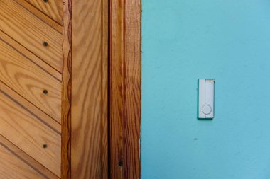 bell switch button on the wall with door