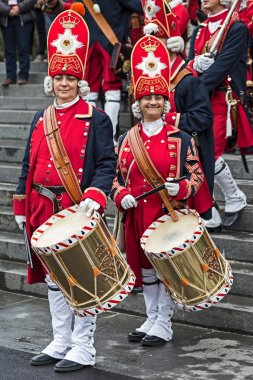 Portrait of medieval soldiers women drummers on the street