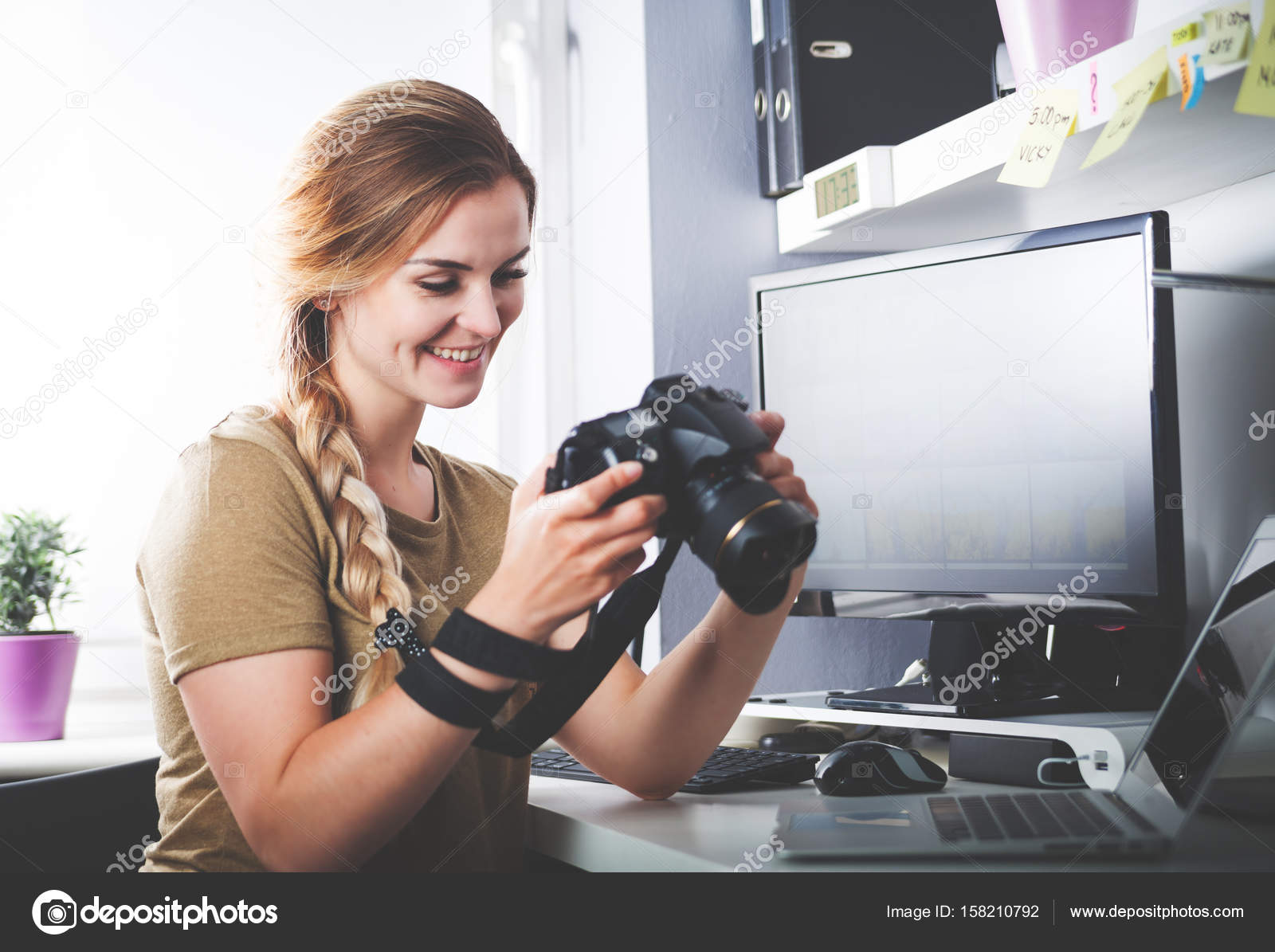 Freelance photographer woman with camera at home office