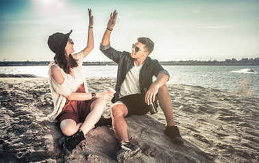 Happy couple outdoor, fashion styled friends have fun