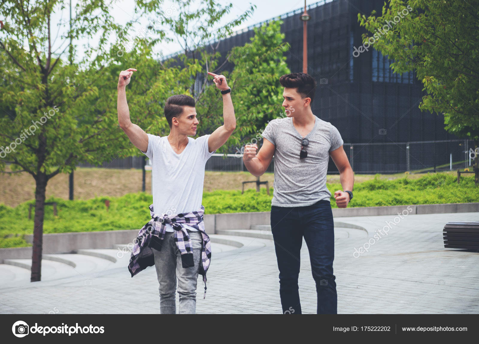 two friends walking in town and singing best friend stock photo