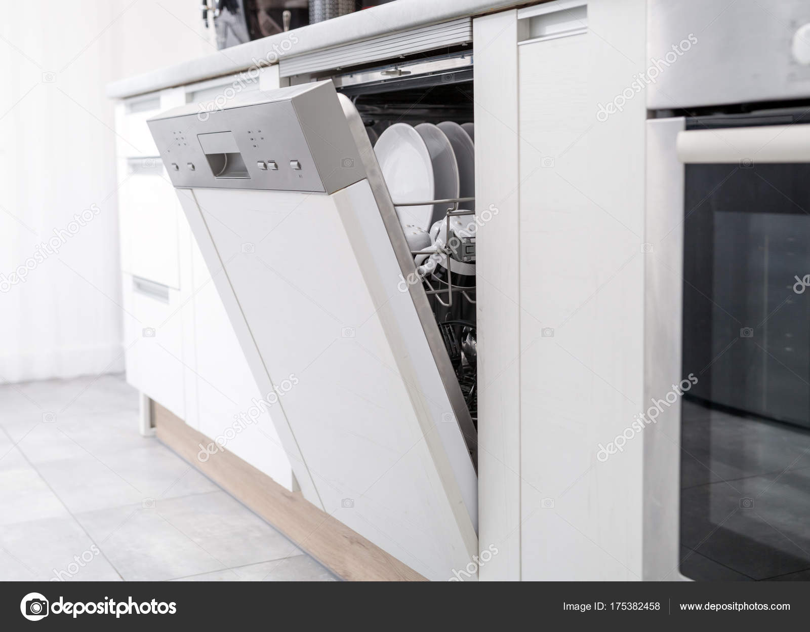 Open dishwasher with clean dishes in white kitchen — Stock Photo ...