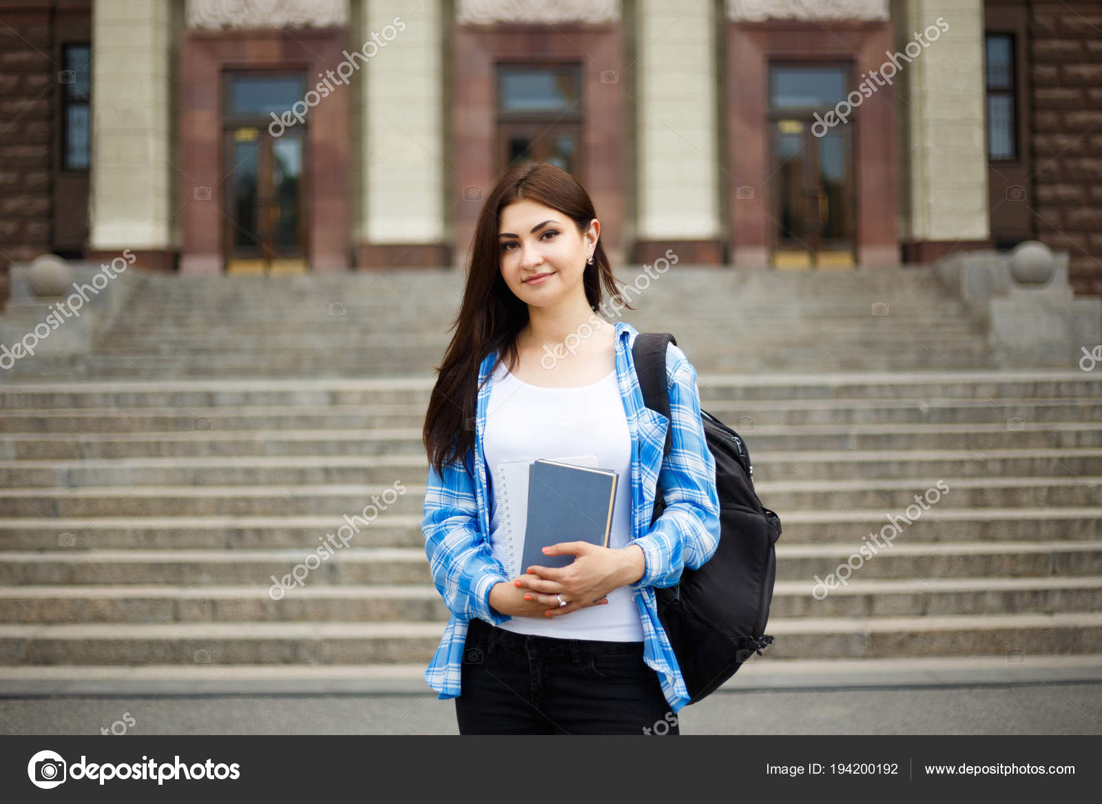 Student girl with books and backpack standing near university bu — Stock  Photo © Wadym #194200192