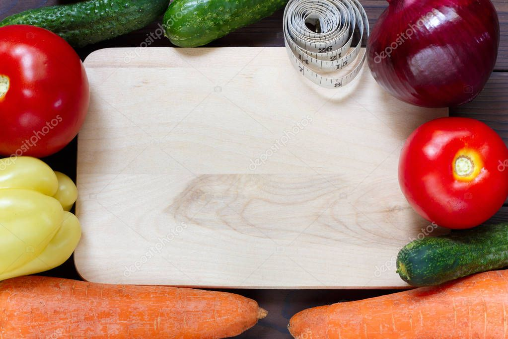 Fresh organic vegetables with measuring tape, free space for tex