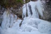 Vodopád Vysny v zimě v údolí Falcon, Národní park Slovenský ráj, Slovensko