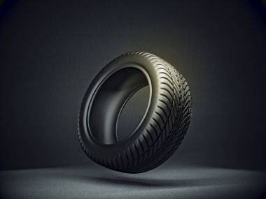 black tire isolated on a dark background. 3d illustration
