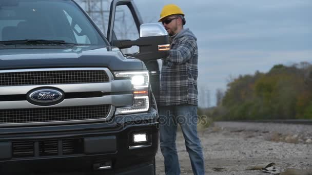 Contractor Field Research Future Construction Site. Field Work. Worker and His Company Pickup Truck Ford F-150
