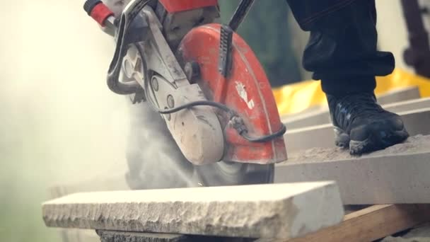 Construction Worker Cutting Stone Using Powerful Stone Cutter Power Tool