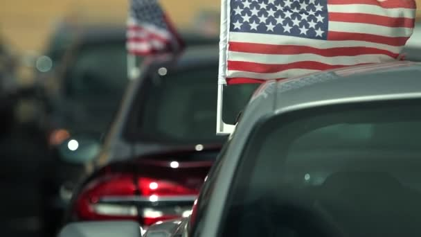 American Made Cars Sale Concept Photo. Brand New Vehicles For Sale with American Flags Attached. Slow Motion Footage