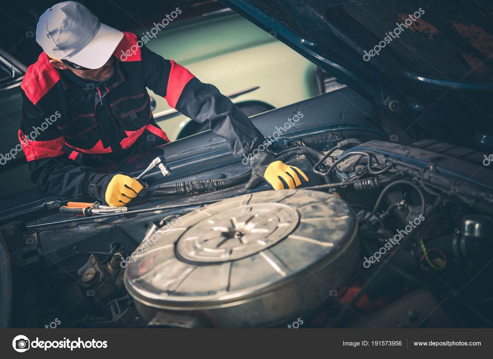 Vintage Car Mechanic — Stock Photo © welcomia #191573956