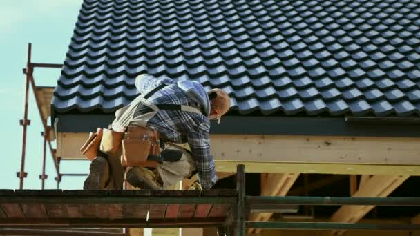 House Construction Theme. Caucasian Contractor in His 30s Working on a Scaffolding.