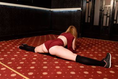 The girl dances tights and shakes her booty.
