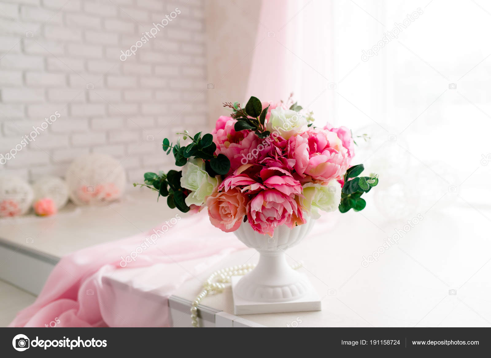 bouquet of peonies in a vase. pink peonies. transparent vase. white