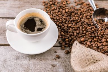 Coffee mug steam and beans