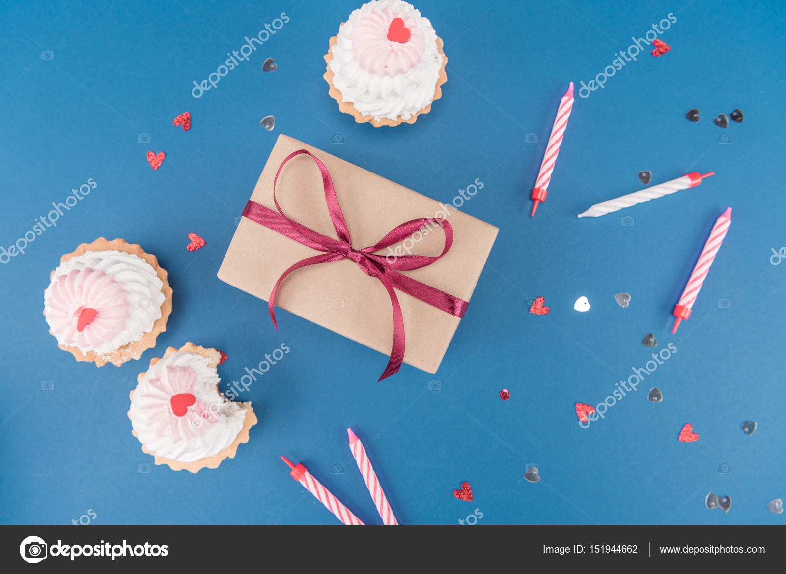 Gift box and cakes stock photo vikakhalabuzar 151944662 top view of gift box cakes and candles isolated on blue birthday party concept photo by vikakhalabuzar negle Choice Image