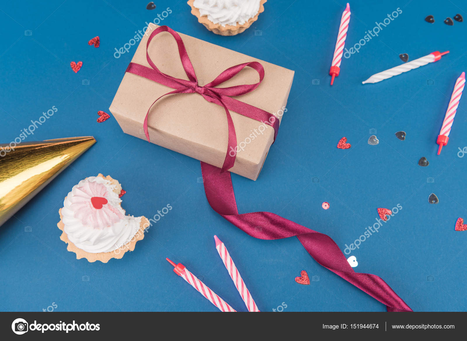 Gift box and cakes stock photo vikakhalabuzar 151944674 side view of gift box cakes and candles isolated on blue birthday party concept photo by vikakhalabuzar negle Images