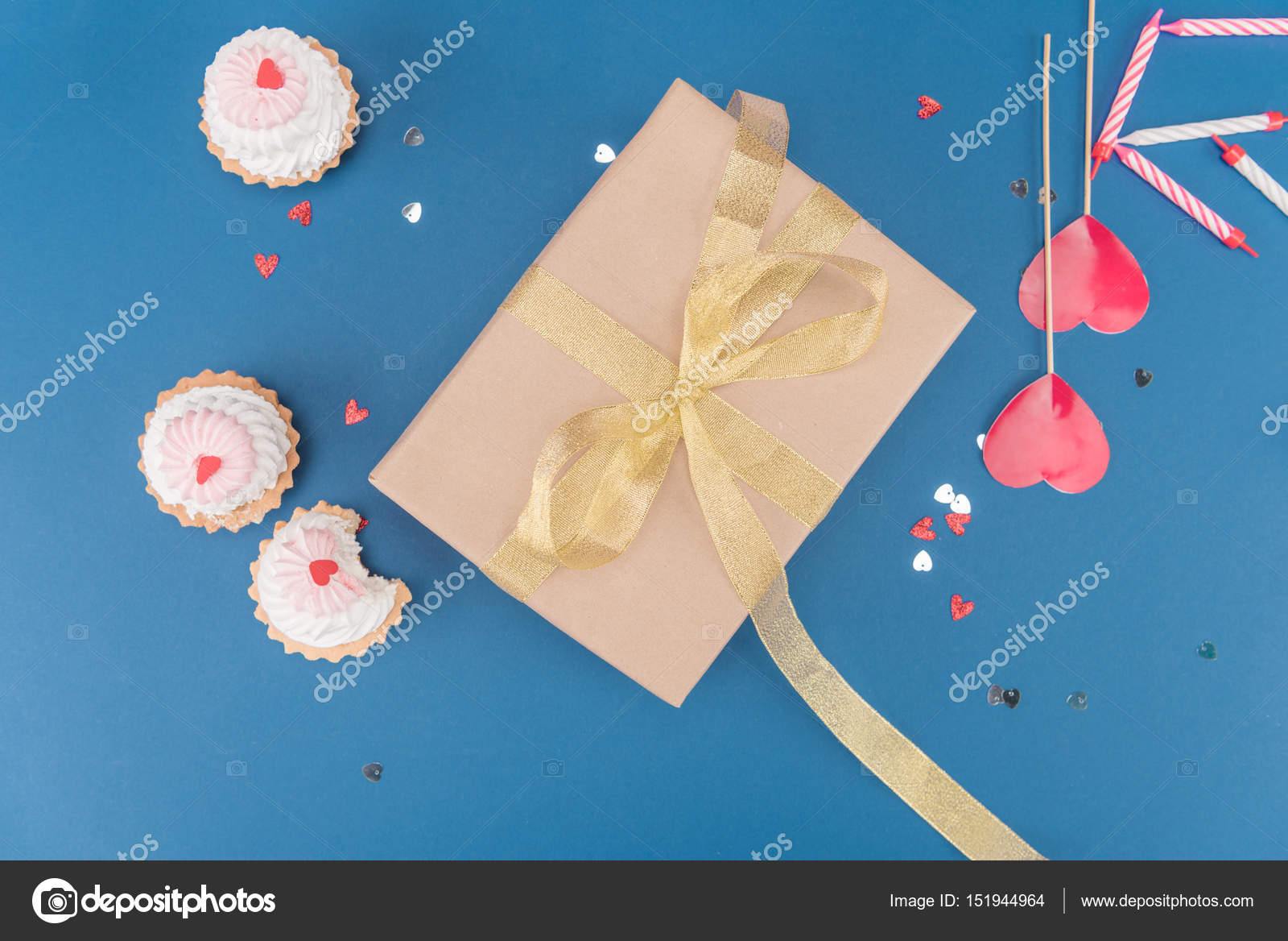 Gift box and cakes stock photo vikakhalabuzar 151944964 top view of gift box cakes and candles isolated on blue birthday party concept photo by vikakhalabuzar negle Images
