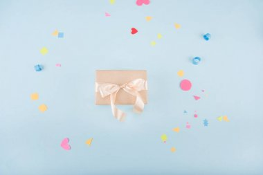 gift box with ribbon and confetti