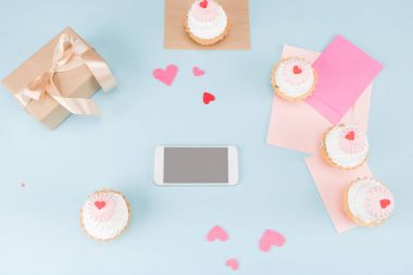 cakes with smartphone and gift box