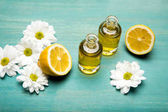 Fotografie Essential oil with lemon and chamomiles