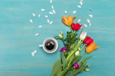 Beautiful flowers and cup of coffee