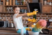 Fotografie Girl with cleaning supplies