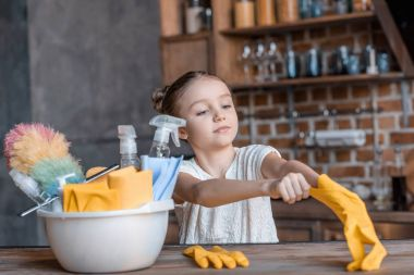 Girl with cleaning supplies