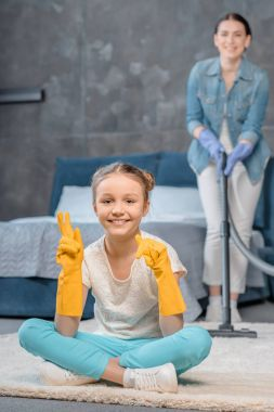Mother and daughter cleaning home