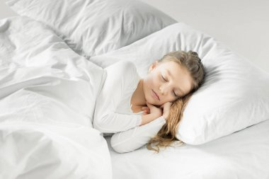 Adorable girl in bed